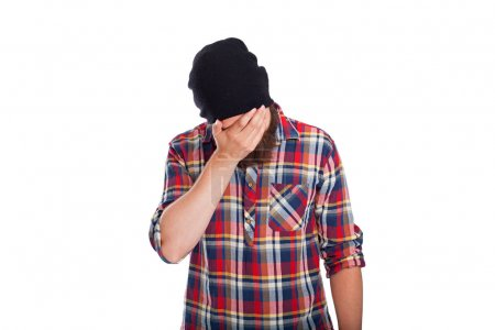 Photo for Man doing facepalm or cover his eyes and face with palm - Royalty Free Image
