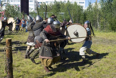"""Demonstration performances of fighters fencing swords, axes and shields. Festival of historical reconstruction clubs """"Slavic mill"""" in Langepas."""