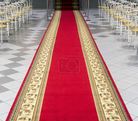 Red carpet in an empty auditorium.
