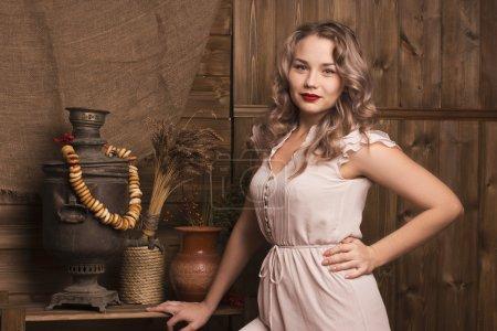 Beautiful woman on rustic kitchen...