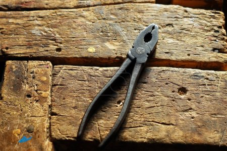 Pliers on the wooden table