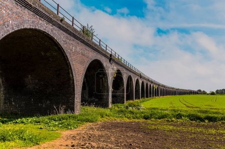 Photo for A ground-level view of the abandoned railway viaduct at Fledborough, Nottinghamshire in springtime - Royalty Free Image