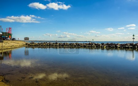 Photo for A view across the beach lagoon towards the longest pleasure pier in the world at Southend-on-Sea, UK in Autumn - Royalty Free Image