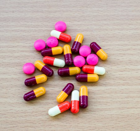diferent Tablets pills capsule heap mix therapy drugs doctor flu