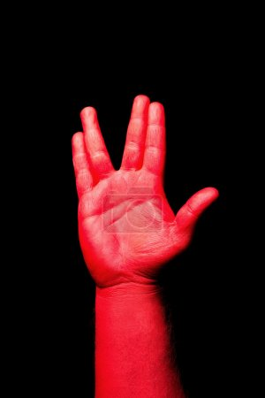 Red hand making gesture