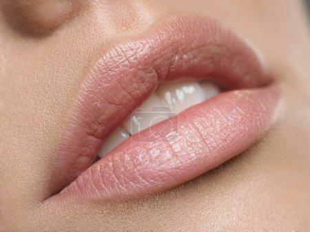 Natural lips. Close up shoot of young beautiful gi...