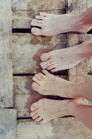 Feet lovers on the bridge