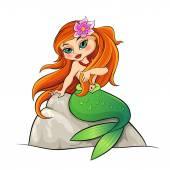 Mermaid sitting on the rock