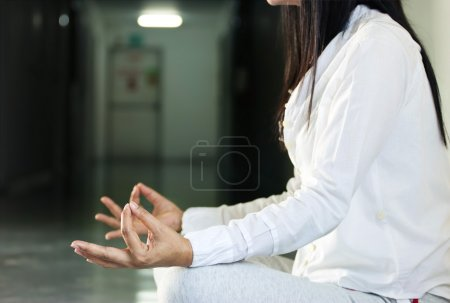 Close up of  woman meditating  in hall