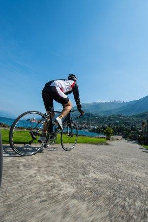 Photo for Race speed biker on garda lake italy - Royalty Free Image