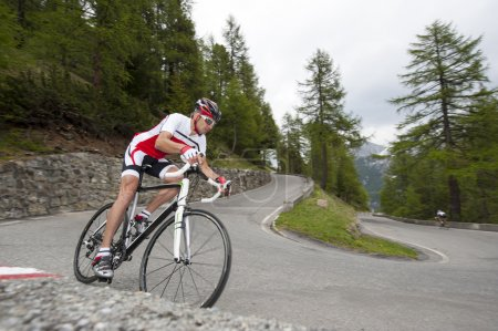 Photo for Cyclist dby downhill with road bike - Royalty Free Image