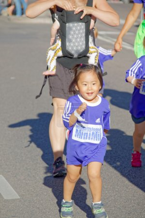 Happy young asian girl running