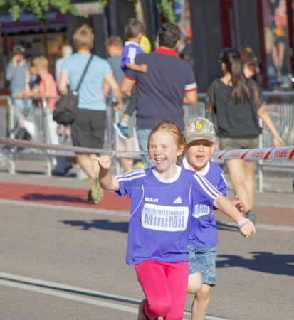 Happy young girl and boy running