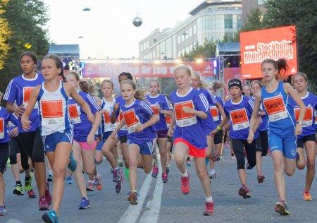 Group of running girls in blue dresses