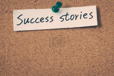 Success stories note pinned on the bulletin board