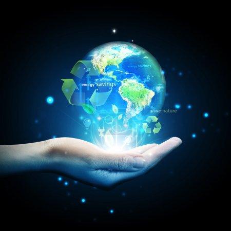 World globe on hand with energy saving concept
