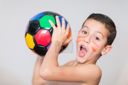 Portrait of a child with a soccer ball