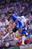 Didier Drogba (L) and Raul Albiol (R) in action