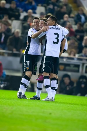 Aritz Aduriz (L), Marius Stankevicius (C) and  Hedwiges Maduro (R) celebrate scoring a goal