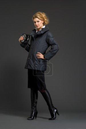 Young beautiful woman in winter clothes at studio...