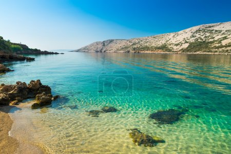 The pristine coastline and crystal clear water of the island of