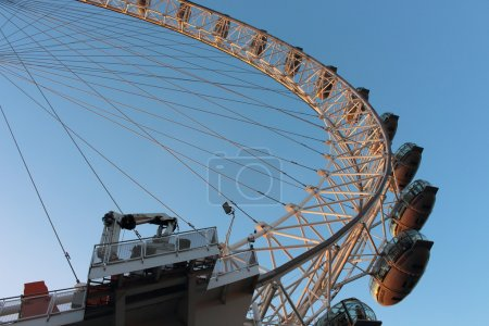 London Eye in Waterloo, London  - February 15th of 2015: This is the third largest ferris wheel all around the world. This tourist attraction is 135 meters tall with a diameter of 120 metres.