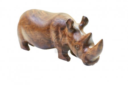 Rhinoceros rhino sculpture made of carved brown wood isolated