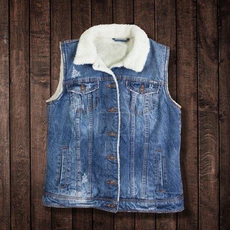 Blue jeans jacket for women on wood...