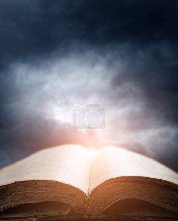 bible over sunset sky