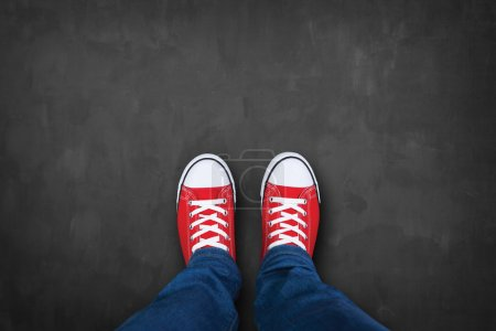 Photo for Red sneakers on a chalkboard - Royalty Free Image