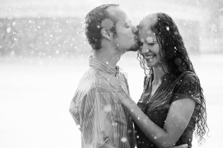 kissing couple under summer rain