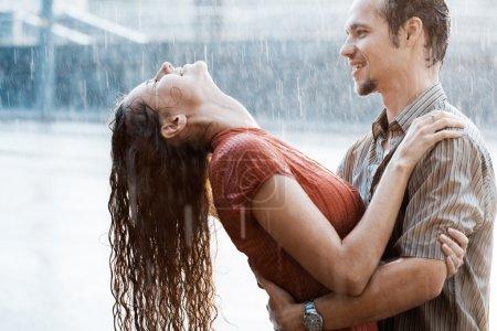Couple in love under rain