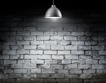 Photo for Brick grunge wall and ceiling lamp - Royalty Free Image