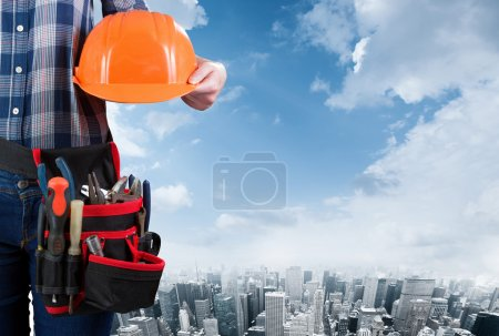 Woman with helmet and toolbelt