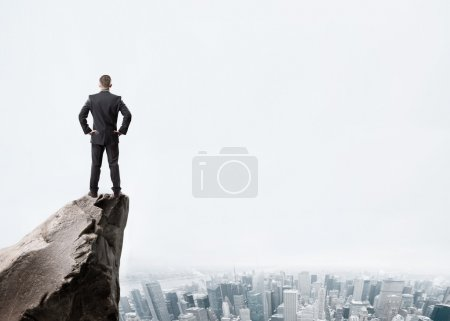 Businessman on mountain top