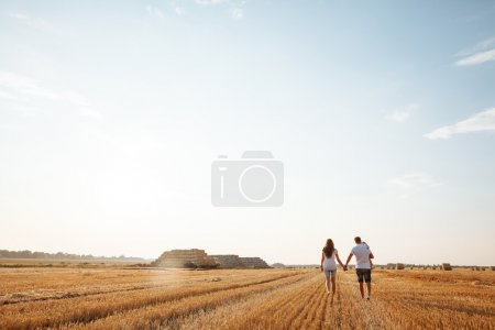 Happy family having fun in a field