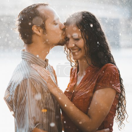 Couple in love under rain