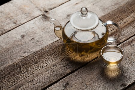 Photo for Green tea with jasmine a in a glass teapot - Royalty Free Image