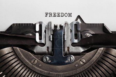 typewriter with paper sheet. freedom concept
