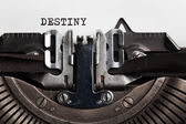 Destiny. typewriter with paper sheet.