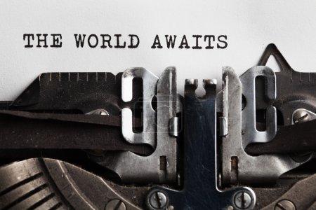 World awaits sign written by typewriter