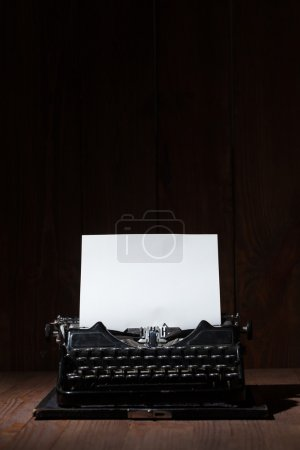Typewriter on a wooden table