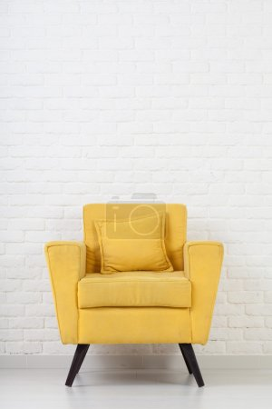 White wall texture with a retro armchair