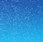 Padající sníh na modrém pozadí