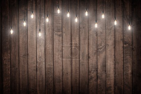 Light bulbs on dark chalkboard background