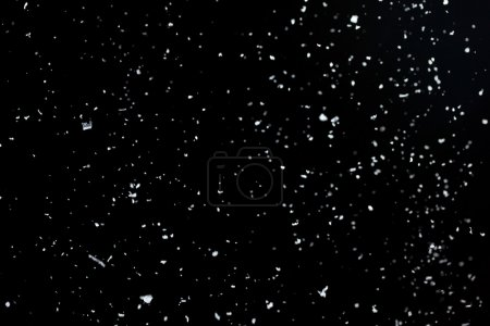 Snow on a black background for use as an overlay layer