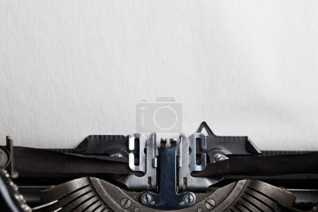 Photo for Empty sheet of a paper for your text inserted into a typewriter - Royalty Free Image