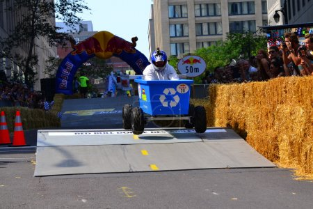 Montreal, Canada - September 06, 2015: Montreal Red Bull Soapbox Race in Montreal Downtown.A lot of fun and ingenious ideas.Number 30-Histoire de recyclage Quebec team.