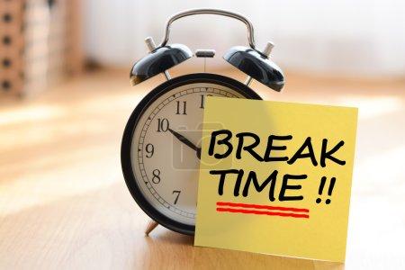 clock with sticker Break time