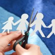Family divorce concept with white paper human figu...